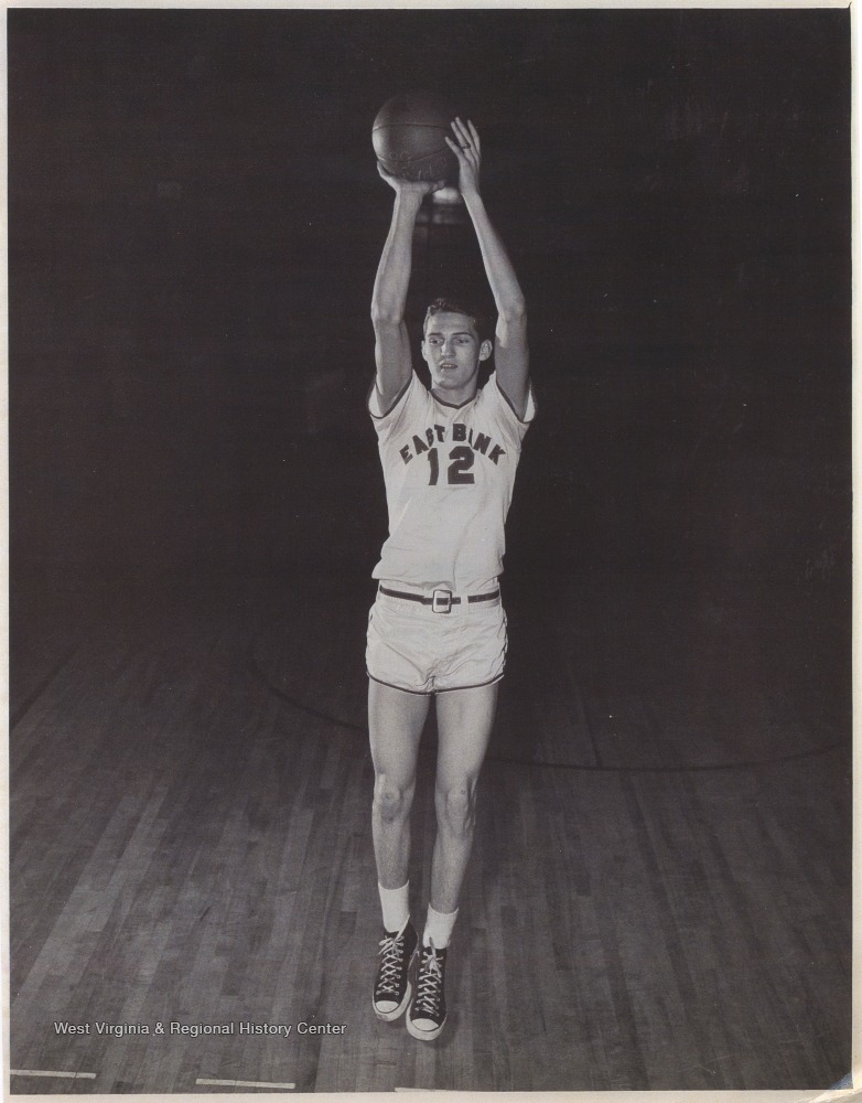 "[""West played as the team's starting small forward. He was named All-State from 1953–56, then All-American in 1956 when he was West Virginia Player of the Year, becoming the state's first high-school player to score more than 900 points in a season.""]"