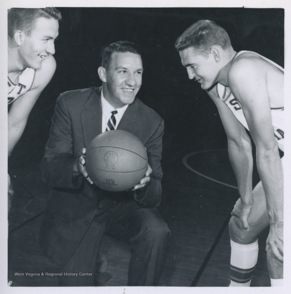 "[""West, right, is pictured with Willie Akers, left, and Coach Fred Schaus, center. West played for West Virginia University's basketball team from 1956-1960, before he was drafted by the Los Angeles Lakers. ""]"