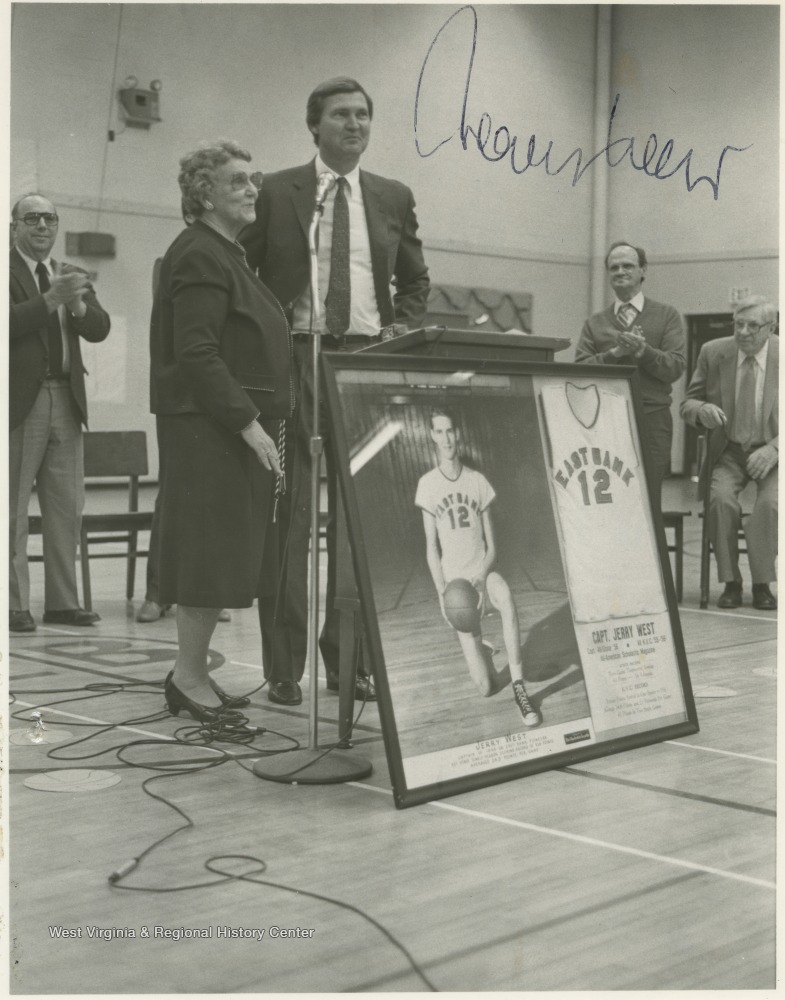 "[""West poses with his fourth grade teacher, Wilhelmina Johnson, during the ceremony to rename the high school's gym the \""Jerry West Gymnasium.\""""]"
