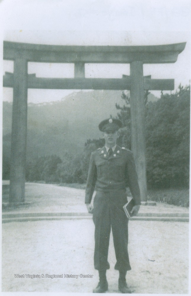 "[""West is pictured in front of a Japanese structure after he has made a recovery from hepatitis.  He was the older brother of basketball star Jerry West. David was awarded the Bronze Star for meritorious service after dragging a fellow soldier from a rice paddy after he was hit. David died in the Korean War at age 22 when Jerry was 12.""]"