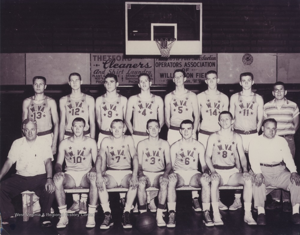 "[""In the front row, left to right, are Coach Tony Gentile (Williamson), Butch Goode (Pineville), George Ritchey (Chattaroy), Jay Jacobs (Morgantown), Mickey Neal (Williamson), Ed Christie (Clarksburg-Washington Irving), Coach Tony Folio (Clarksburg-Washington Irving).  In the back row, left to right, are Jim Warren (Clarksburg-Washington Irving), Jerry West (East Bank), Howard Hurt (Beckley), Jim McDonald (Bridgeport), Carl Johnson (Williamson), Willie Akers (Mullens), Larry Brothers (Parkersburg), and an unidentified manager.""]"