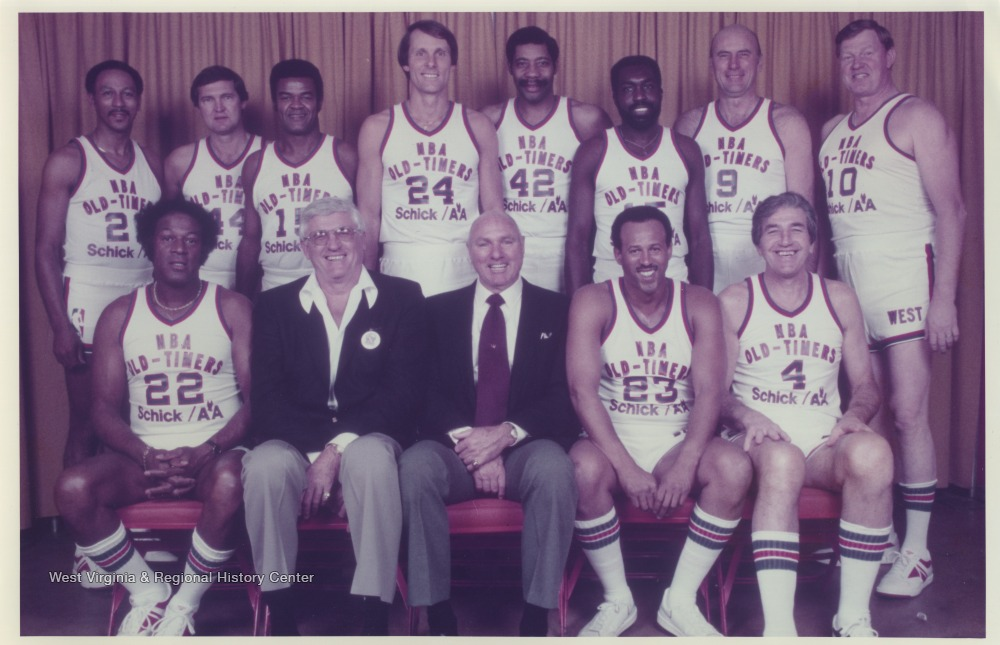 "[""In the front row, from left to right, is Elgin Baylor, George Mikan, Coach Alex Hannum, Lou Hudson, and Dolph Schayes.In the back row, from left to right, is David Bing, Jerry West, Hal Greer, Rick Barry, Connie Hawkins, Earl Monroe, Bob Pettit and Johnny 'Red' Kerr. ""]"