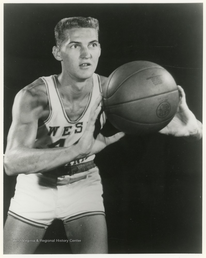 "[""Jerry West played basketball for WVU from 1956-1960 during which time he had a number of achievements in the sport with the team.  He later played for the LA Lakers in the NBA before becoming a coach and manager.""]"