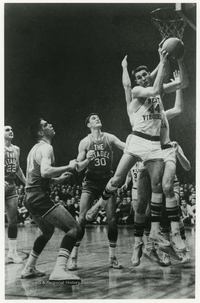 "[""West scores a rebound in a Southern Conference tournament against The Citadel. WVU won this game 85-66.""]"