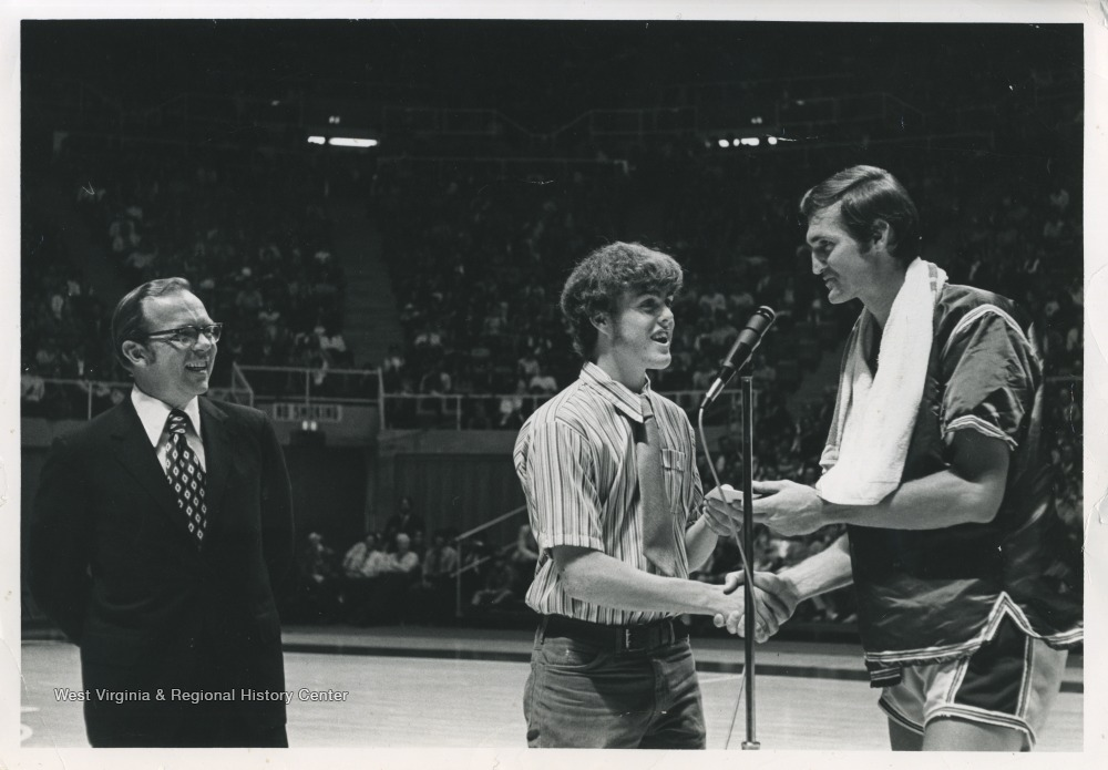 "[""Jerry West presents the first annual Jerry West Scholarship to Kenneth Tawney of Spencer, W. Va. Tawney attended WVU, subsequently earning a law degree.""]"