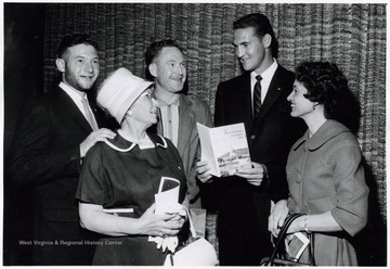 A photograph of Jerry West (second from right) standing with Louise Larkey (right) and Victor Larkey (far left) of Weirton, W. Va., Mrs. O. J. White (front left) of Morgantown, W. Va., and Red Lyons (rear right) of Raleigh County, W. Va.