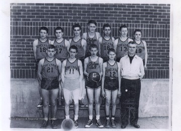 Jerry West is Number 12 in the front row, second from the right. He played as the team's starting small forward.