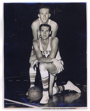 West, No. 44 pictured in the forefront, poses with teammate Willie Akers.