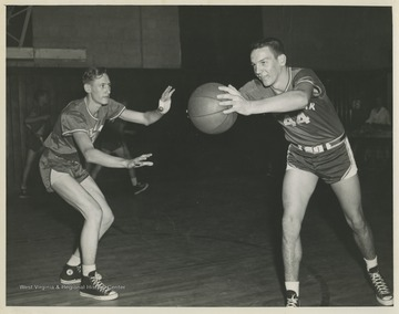 Leonord Greer, left, and Robert Buckley, right, are pictured during a drill at practice. The boys were teammates of Jerry West during his high school basketball career.The 1956 basketball team secured the first ever state championship title for the high school.