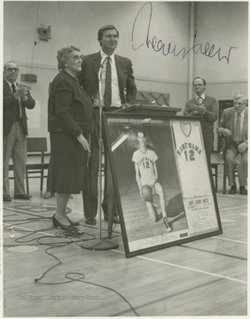 "West poses with his fourth grade teacher, Wilhelmina Johnson, during the ceremony to rename the high school's gym the ""Jerry West Gymnasium."""