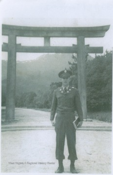 West is pictured in front of a Japanese structure after he has made a recovery from hepatitis.  He was the older brother of basketball star Jerry West. David was awarded the Bronze Star for meritorious service after dragging a fellow soldier from a rice paddy after he was hit. David died in the Korean War at age 22 when Jerry was 12.