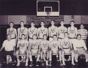In the front row, left to right, are Coach Tony Gentile (Williamson), Butch Goode (Pineville), George Ritchey (Chattaroy), Jay Jacobs (Morgantown), Mickey Neal (Williamson), Ed Christie (Clarksburg-Washington Irving), Coach Tony Folio (Clarksburg-Washington Irving).  In the back row, left to right, are Jim Warren (Clarksburg-Washington Irving), Jerry West (East Bank), Howard Hurt (Beckley), Jim McDonald (Bridgeport), Carl Johnson (Williamson), Willie Akers (Mullens), Larry Brothers (Parkersburg), and an unidentified manager.