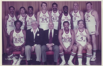 In the front row, from left to right, is Elgin Baylor, George Mikan, Coach Alex Hannum, Lou Hudson, and Dolph Schayes.In the back row, from left to right, is David Bing, Jerry West, Hal Greer, Rick Barry, Connie Hawkins, Earl Monroe, Bob Pettit and Johnny 'Red' Kerr.