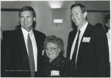 West, left, and Akers, right, pose with Ann Dinardi. West had lived in Dinardi's Beechurst Avenue home during his college basketball days at West Virginia University.
