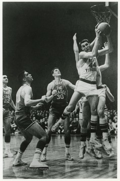 West scores a rebound in a Southern Conference tournament against The Citadel. WVU won this game 85-66.