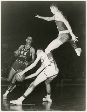 West jumps to block Pitt's Dick Falenski as he attempts to shoot.  The Mountaineers won this game at Pittsburgh, 76-66.