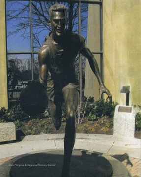 Sculpted by Jamie Lester, the statue was unveiled February 14, 2007 and stands outside the West Virginia University Coliseum.