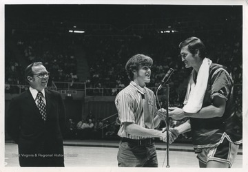 Jerry West presents the first annual Jerry West Scholarship to Kenneth Tawney of Spencer, W. Va. Tawney attended WVU, subsequently earning a law degree.